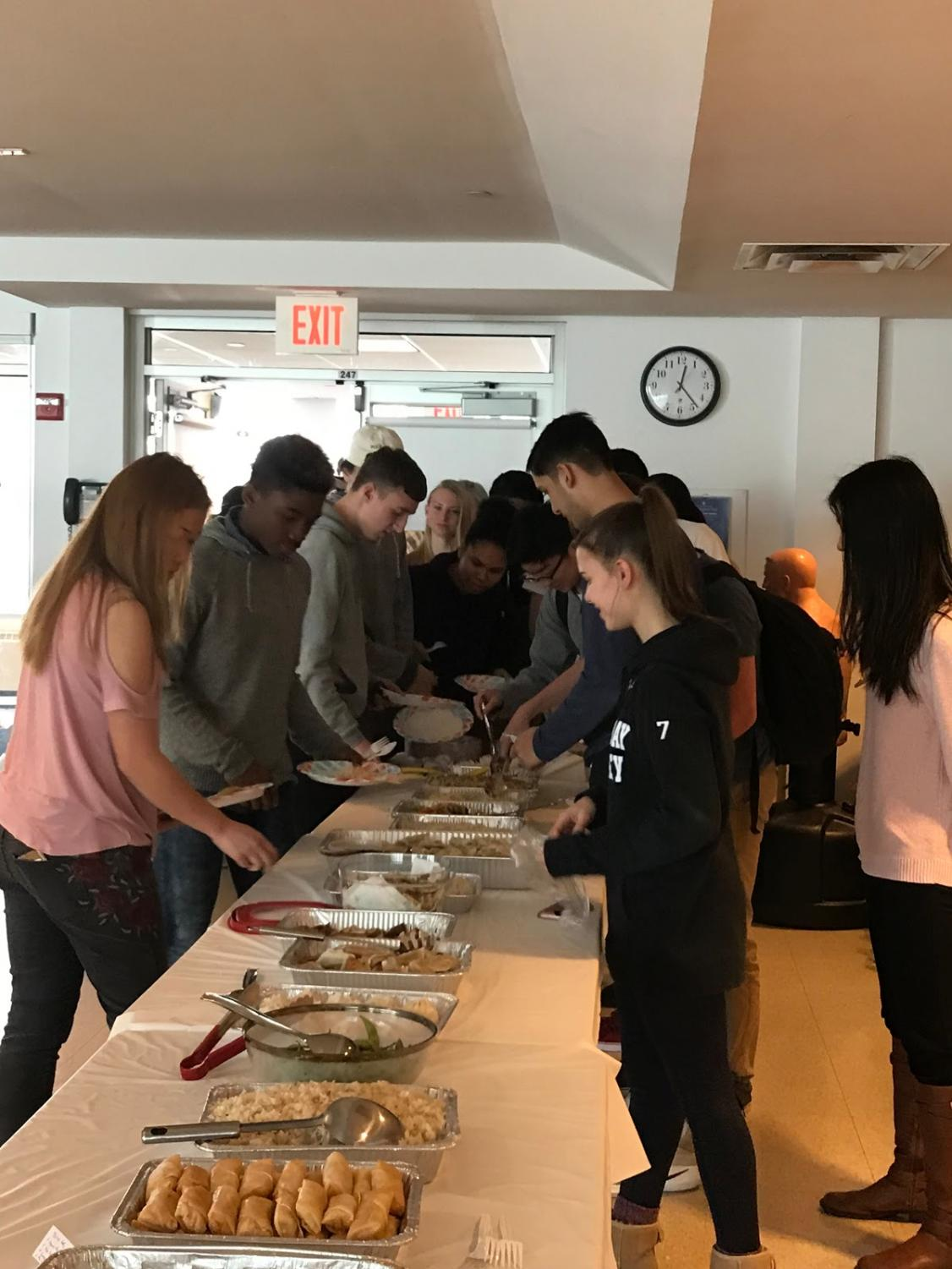 Students try out cultural asian dishes