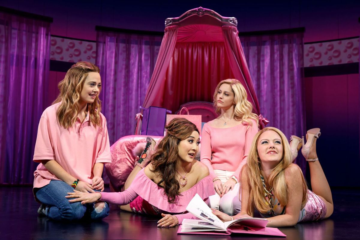 From left: Erika Henningsen (Cady Heron), Ashley Park (Gretchen Wieners), Taylor Louderman (Regina George), and Kate Rockwell (Karen Smith) during a scene of the musical. (Photo by Joan Marcus/Vox)