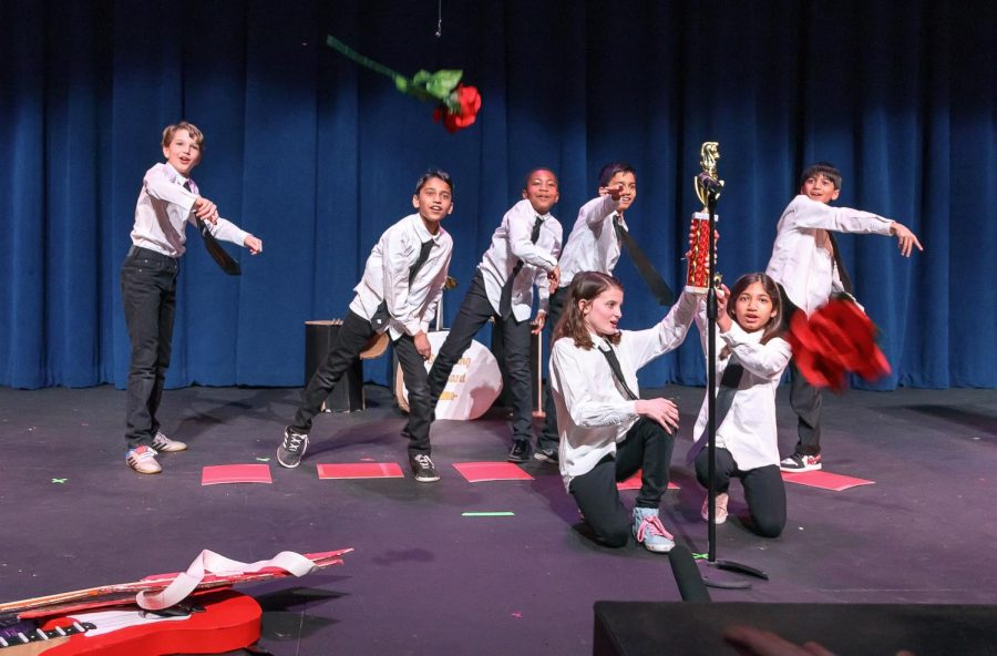 4th Graders throw roses into the adoring crowd during their performance for the Upper School on March 4 (Photo/PDS Flickr)