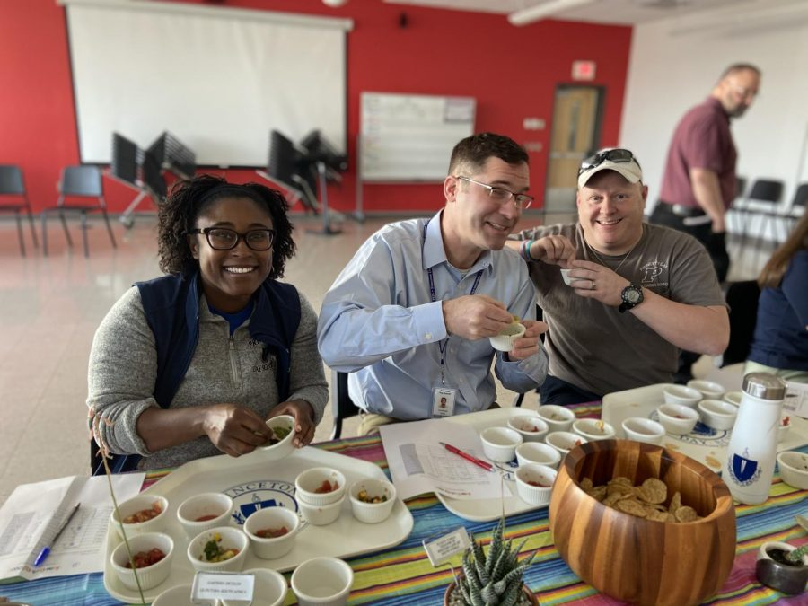 Left to Right: Physics teacher Ms. Allen, History teacher Mr. Rhodes, and Buildings and Grounds member Mr. Devlin review the guacamole submitted for the contest on March 2 2020. (Photo/Katie Jain '21)