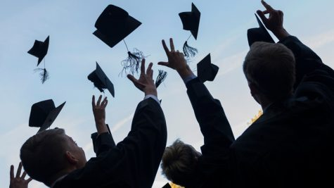 Graduating seniors traditionally throw caps into the air, but this year