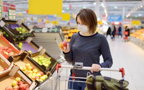 Shoppers frequently wear face masks while buying the goods they need in order to prevent the spread of bacteria.