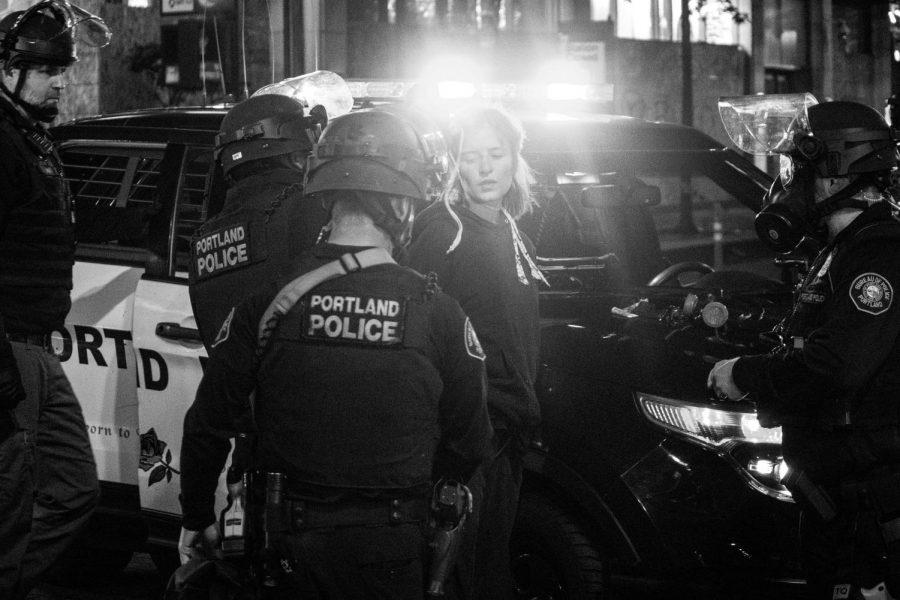 Protester getting arrested during the Black Lives Matter protest in Portland, Oregon. (Photo/Tito Texidor III/ Unsplash)