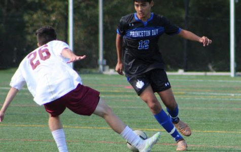 Junior Milan Shah faces off against opponent in the Boys Varsity Soccer game on 10/3. (Photo/Darby McChesney)